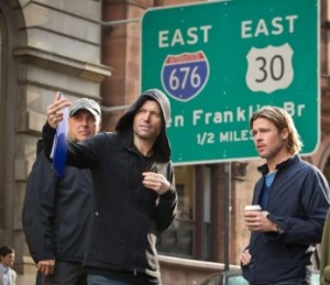 "PHOTO COURTESY OF PARAMOUNT PICTURES Marc Forster directs Brad Pitt in ""World War Z"""